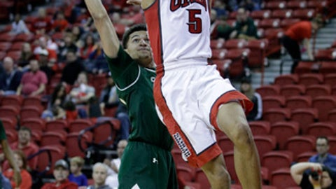 UNLV's Jalen Poyser shoots around Colorado State's Anthony Bonner during the second half of an NCAA college basketball game Saturday, Feb. 4, 2017, in Las Vegas. Colorado State won 69-49. (AP Photo/John Locher)
