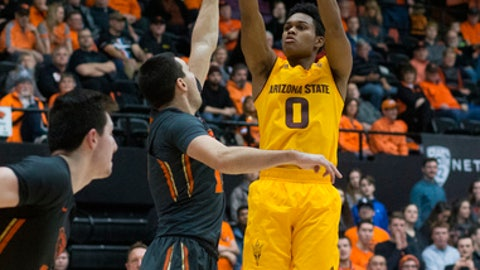 Arizona State's Tra Holder (0) shoots over Oregon State's Tanner Sanders during the second half of an NCAA college basketball game in Corvallis, Ore., Saturday, Feb. 4, 2017. Arizona State won 81-68. (AP Photo/Timothy J. Gonzalez)