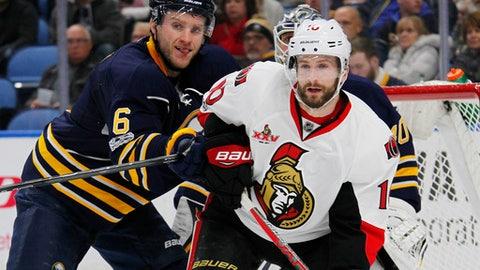 Buffalo Sabres defenseman Cody Franson (6) and Ottawa Senators forward Tom Pyatt (10) battle in front of the net during the second period of an NHL hockey game, Saturday Feb. 4, 2017, in Buffalo, N.Y. (AP Photo/Jeffrey T. Barnes)
