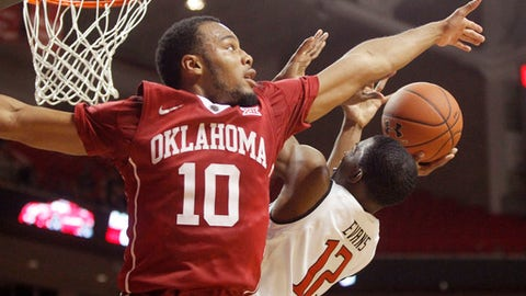 Oklahoma guard Jordan Woodard attempts to block a shot by Texas Tech guard Keenan Evans during the second half of an NCAA college basketball game Saturday, Feb. 4, 2017, in Lubbock, Texas. (Mark Rogers/Lubbock Avalanche-Journal via AP)