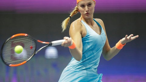 France's Kristina Mladenovic returns the ball to Kazakhstan's Yulia Putintseva during the St. Petersburg Ladies Trophy-2017 tennis tournament final match in St.Petersburg, Russia, Sunday, Feb. 5, 2017. (AP Photo/Dmitri Lovetsky)