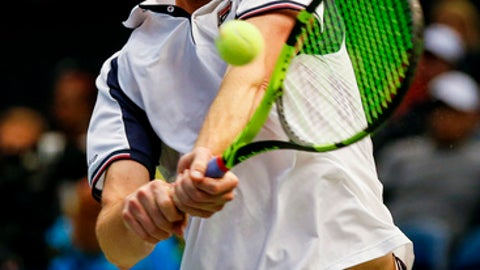 United States' Sam Querrey returns the ball to Switzerland's Adrien Bossel during a Davis Cup tennis match, Sunday, Feb. 5, 2017, in Birmingham, Ala. (AP Photo/Butch Dill)