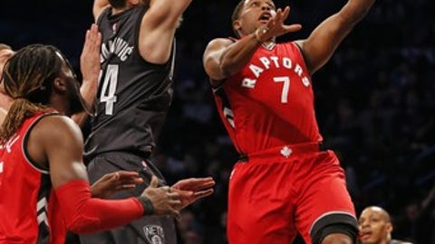 Brooklyn Nets guard Bojan Bogdanovic (44) defends as Toronto Raptors guard Kyle Lowry (7) goes up for a layup during the first half of an NBA basketball game, Sunday, Feb. 5, 2017, in New York. (AP Photo/Kathy Willens)