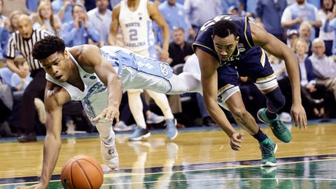 North Carolina's Isaiah Hicks, left, and Notre Dame's Bonzie Colson chase the ball during the second half of an NCAA college basketball game in Greensboro, N.C., Sunday, Feb. 5, 2017. (AP Photo/Gerry Broome)