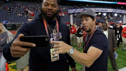 Seattle Seahawks' Michael Bennett, left, takes selfie with actor Mark Wahlberg before the NFL Super Bowl 51 football game Sunday, Feb. 5, 2017, in Houston. (AP Photo/David J. Phillip)