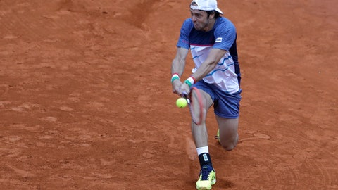 Italy's Paolo Lorenzi returns the ball to Argentina's Carlos Berlocq during the Davis Cup first round tennis match in Buenos Aires, Argentina, Sunday, Feb. 5, 2017. (AP Photo/Natacha Pisarenko)