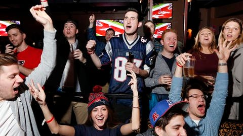 Fans at a Boston bar react while watching the first half of NFL Super Bowl 51 football game in Houston, Sunday, Feb. 5, 2017. (AP Photo/Michael Dwyer)