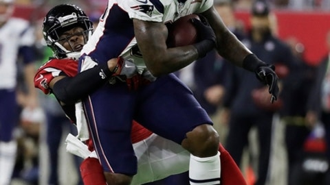 New England Patriots' Martellus Bennett, right, is tackled by Atlanta Falcons' Deji Olatoye during the first half of the NFL Super Bowl 51 football game Sunday, Feb. 5, 2017, in Houston. (AP Photo/Chuck Burton)