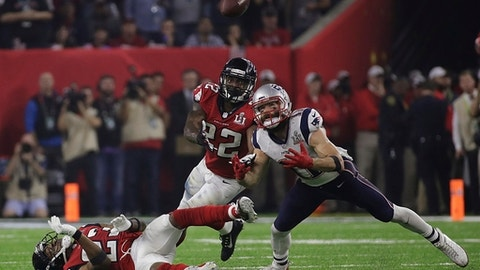 New England Patriots' Julian Edelman eyes the ball before making the catch as Atlanta Falcons' Robert Alford, left, and Keanu Neal defend, during the second half of the NFL Super Bowl 51 football game Sunday, Feb. 5, 2017, in Houston. (AP Photo/Patrick Semansky)