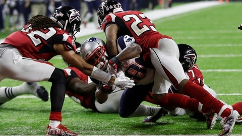 New England Patriots' James White scores the winning touchdown between Atlanta Falcons' Jalen Collins, left, and Robert Alford during overtime of the NFL Super Bowl 51 football game Sunday, Feb. 5, 2017, in Houston. (AP Photo/Elise Amendola)
