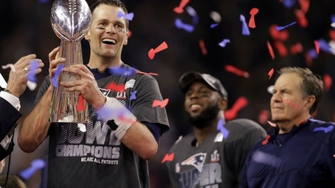 New England Patriots' Tom Brady holds the Vince Lombardi Trophy after defeating the Atlanta Falcons in overtime at the NFL Super Bowl 51 football game Sunday, Feb. 5, 2017, in Houston. The Patriots defeated the Falcons 34-28. At right is Patriots head coach Bill Belichick. (AP Photo/Darron Cummings)