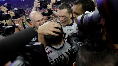 New England Patriots' Tom Brady celebrates with teammate Julian Edelman after the team defeated the Atlanta Falcons in overtime at the NFL Super Bowl 51 football game Sunday, Feb. 5, 2017, in Houston. The Patriots defeated the Falcons 34-28. (AP Photo/Darron Cummings)