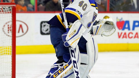 Saint Louis Blues' Carter Hutton watches the action up ice during the second period of an NHL hockey game against the Philadelphia Flyers, Monday, Feb. 6, 2017, in Philadelphia. Hutton had a shutout in the Blues' 2-0 win. (AP Photo/Tom Mihalek)