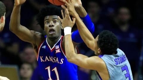 Kansas guard Josh Jackson (11) rebounds against Kansas State guard Kamau Stokes (3) during the first half of an NCAA college basketball game in Manhattan, Kan., Monday, Feb. 6, 2017. (AP Photo/Orlin Wagner)