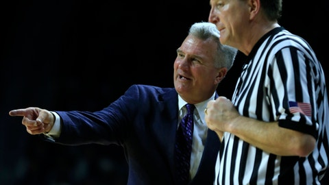 Kansas State head coach Bruce Weber talks with an official during the first half of an NCAA college basketball game against Kansas in Manhattan, Kan., Monday, Feb. 6, 2017. (AP Photo/Orlin Wagner)