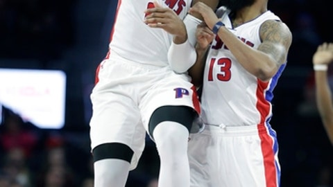 Detroit Pistons center Andre Drummond, left, is congratulated by teammate forward Marcus Morris (13) after a dunk during the second half of an NBA basketball game against the Philadelphia 76ers, Monday, Feb. 6, 2017, in Auburn Hills, Mich. (AP Photo/Carlos Osorio)