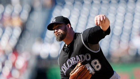 FILE - In this Aug. 28, 2016, file photo, Colorado Rockies relief pitcher Boone Logan delivers a pitch during a baseball game against the Washington Nationals in Washington. The Cleveland Indians have signed Logan to a one-year contract. Logan's deal includes a club option for the 2018 season. Logan appeared in 126 games over the past two seasons for the Colorado Rockies. (AP Photo/Nick Wass, File)