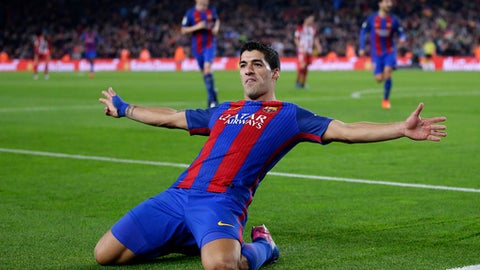 Barcelona's Luis Suarez celebrates after scoring the opening goal during the the Copa del Rey semifinal second leg soccer match between FC Barcelona and Atletico Madrid at the Camp Nou stadium in Barcelona, Spain, Tuesday Feb. 7, 2017. (AP Photo/Manu Fernandez)