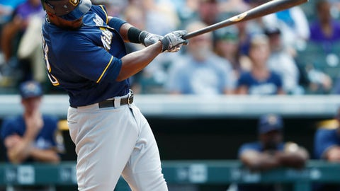 Milwaukee Brewers' Chris Carter connects for a single off Colorado Rockies relief pitcher Carlos Estevez in the eighth inning of a baseball game, Sunday, Oct. 2, 2016, in Denver. Milwaukee won 6-4 in 10 innings. (AP Photo/David Zalubowski)
