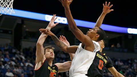 Penn State's Tony Carr (10) goes to the basket as Maryland's Michal Cekovsky (15) and Anthony Cowan (0) defend during the first half of an NCAA college basketball game in State College, Pa., Tuesday, Feb. 7, 2017. (AP Photo/Chris Knight)