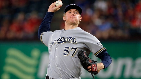 FILE - This Sept. 28, 2016 file photo shows Milwaukee Brewers starting pitcher Chase Anderson (57) throwing to the Texas Rangers in the first inning of a baseball game in Arlington, Texas. Salary arbitration decisions for starting pitchers who are eligible for the first time will be held back until all the cases involving those players are finished. Anderson argued his case with the Milwaukee Brewers on Monday, Feb. 6, 2017 but must wait for agreements or hearings involving Houston's Collin McHugh, Tampa Bay's Jake Odorizzi, Toronto's Marcus Stroman, St. Louis' Michael Wacha and Arizona's Taijuan Walker. (AP Photo/Tony Gutierrez)