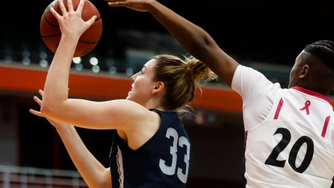 Connecticut's Katie Lou Samuelson (33) shoots against Cincinnati's Maya Benham (20) during the first half of an NCAA college basketball game Tuesday, Feb. 7, 2017, in Cincinnati. (AP Photo/John Minchillo)
