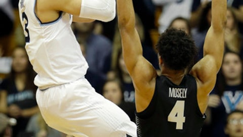 Villanova's Josh Hart, left, goes up for a shot against Georgetown's Jagan Mosely during the first half of an NCAA college basketball game, Tuesday, Feb. 7, 2017, in Villanova, Pa. (AP Photo/Matt Slocum)