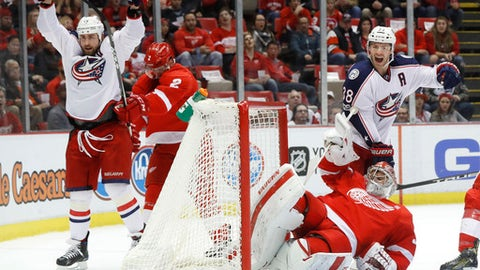 Columbus Blue Jackets center Brandon Dubinsky, left, celebrates his goal against Detroit Red Wings goalie Petr Mrazek (34) as Boone Jenner (38) looks on in the first period of an NHL hockey game Tuesday, Feb. 7, 2017, in Detroit. (AP Photo/Paul Sancya)