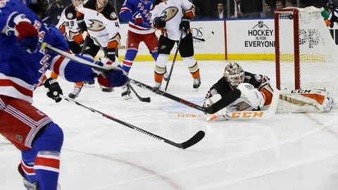 New York Rangers' Mats Zuccarello, left, shoots the puck past Anaheim Ducks goalie John Gibson, right, during the second period of an NHL hockey game Tuesday, Feb. 7, 2017, in New York. (AP Photo/Frank Franklin II)