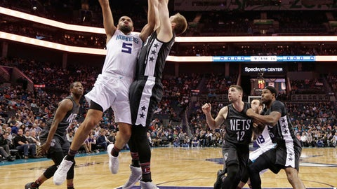 Charlotte Hornets' Nicolas Batum (5) drives against Brooklyn Nets' Justin Hamilton (41) in the first half of an NBA basketball game in Charlotte, N.C., Tuesday, Feb. 7, 2017. (AP Photo/Chuck Burton)