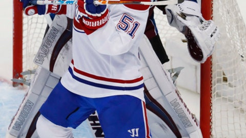 Montreal Canadiens center David Desharnais, front, screens Colorado Avalanche goalie Calvin Pickard during the first period of an NHL hockey game Tuesday, Feb. 7, 2017, in Denver. (AP Photo/David Zalubowski)