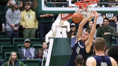 Utah State forward Quinn Taylor dunks against Colorado State in an NCAA college basketball game, Tuesday Feb. 7, 2017, at Moby Arena in Fort Collins, Colo. (Brian Smith/Fort Collins Coloradoan via AP)