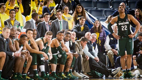 Michigan State guard Miles Bridges (22) stands by his bench with teammates in dejection at the end of an NCAA college basketball game against Michigan at Crisler Center in Ann Arbor, Mich., Tuesday, Feb. 7, 2017. Michigan won 86-57. (AP Photo/Tony Ding)