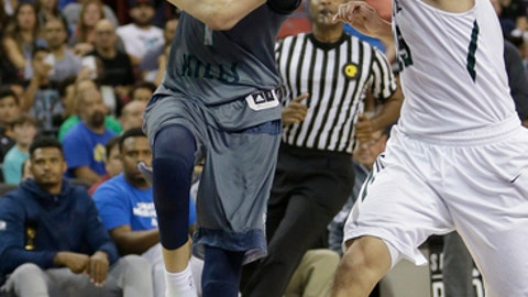 FILE - In this March 26, 2016, file photo, Chino Hills' Lamelo Ball, left, goes to the basket against De La Salle's Jordan Ratinho during the second half of the CIF boys' Open Division high school basketball championship game in Sacramento, Calif. Chino Hills won 70-50. Ball scored 92 points to help Chino Hills beat Los Osos 146-123 on Tuesday, Feb. 7, 2017. (AP Photo/Rich Pedroncelli, File)