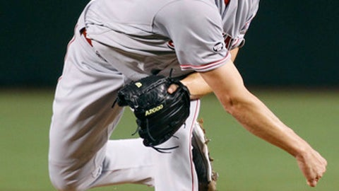 Cincinnati Reds starting pitcher Homer Bailey throws against the Arizona Diamondbacks during the first inning of a baseball game, Sunday, Aug. 28, 2016, in Phoenix. The Diamondbacks defeated the Reds 11-2. (AP Photo/Ralph Freso)