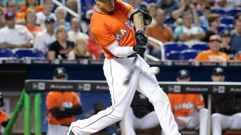 Miami Marlins' Giancarlo Stanton bats during the third inning of a baseball game against the New York Mets, Sunday, July 24, 2016, in Miami. Stanton ground out on the play. (AP Photo/Lynne Sladky)