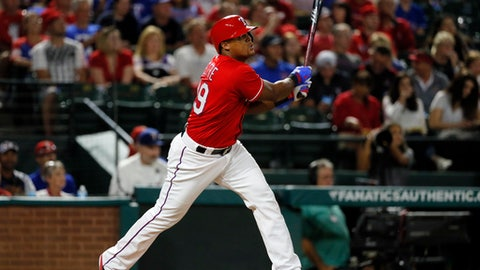 FILE - In this Sept. 30, 2016, file photo, Texas Rangers' Adrian Beltre follows through on a double to center off a pitch from Tampa Bay Rays' Matt Andriese in the third inning of a baseball game in Arlington, Texas. Beltre goes into his 20th major league season only 58 hits shy of 3,000 in his career, and after winning his fifth Gold Glove last year. (AP Photo/Tony Gutierrez, File)