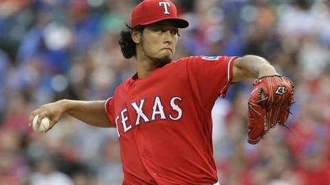 FILE - In this July 27, 2016, file photo, Texas Rangers starting pitcher Yu Darvish throws during the third inning of a baseball game against the Oakland Athletics in Arlington, Texas. Darvish and Cole Hamels, the Rangers two aces, are set to start a season in the rotation together for the first time.(AP Photo/LM Otero, File)
