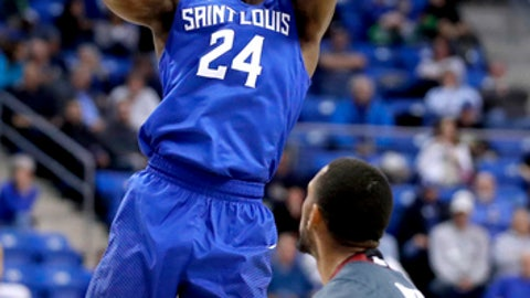 Saint Louis' Aaron Hines (24) shoots as Massachusetts' Zach Lewis watches during the second half of an NCAA college basketball game, Wednesday, Jan. 25, 2017, in St. Louis. Saint Louis won 74-70. (AP Photo/Jeff Roberson)