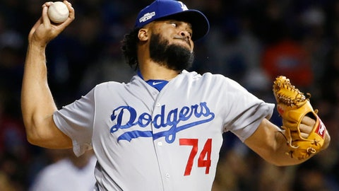 FILE - In this Oct. 22, 2016, file photo, Los Angeles Dodgers relief pitcher Kenley Jansen (74) throws during the sixth inning of Game 6 of the National League baseball championship series against the Chicago Cubs, in Chicago. After coming within two games of reaching the World Series, the Dodgers had a simple plan going into the offseason: keep their roster intact and make a couple of additions. They re-signed key free agents Kenley Jansen, Justin Turner and Rich Hill. (AP Photo/Nam Y. Huh, File)