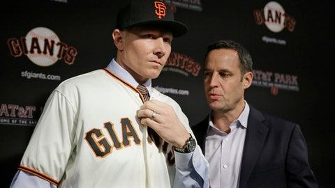 FILE - In this Dec. 9, 2016, file photo, San Francisco Giants pitcher Mark Melancon, left, with his agent, Mark Pieper, right, after he was introduced at AT&T Park in San Francisco. The Giants look to closer Melancon to help steady their bullpen. (AP Photo/Eric Risberg, File)