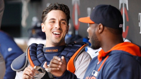 FILE - In this Aug. 28, 2015, file photo, Houston Astros catcher Jason Castro laughs with a teammate in the dugout before a baseball game against the Minnesota Twins in Minneapolis. The Twins signed Castro to a three-year, $24.5 million contract. (AP Photo/Ann Heisenfelt, File)