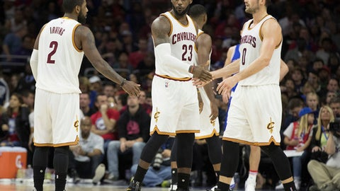 PHILADELPHIA, PA - NOVEMBER 5: LeBron James #23, Kyrie Irving #2, and Kevin Love #0 of the Cleveland Cavaliers celebrate against the Philadelphia 76ers at Wells Fargo Center on November 5, 2016 in Philadelphia, Pennsylvania. The Cavaliers defeated the 76ers 102-101. The NOTE TO USER: User expressly acknowledges and agrees that, by downloading and or using this photograph, User is consenting to the terms and conditions of the Getty Images License Agreement. (Photo by Mitchell Leff/Getty Images)