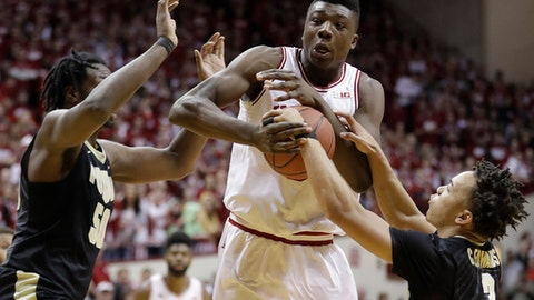 Indiana's Thomas Bryant, middle, is defended by Purdue's Caleb Swanigan and Carsen Edwards, right, during the second half of an NCAA college basketball game Thursday, Feb. 9, 2017, in Bloomington, Ind. Purdue defeated Indiana 69-64. (AP Photo/Darron Cummings)