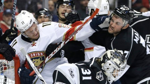 Florida Panthers' Jonathan Huberdeau (11) hits Los Angeles Kings' Alec Martinez, right, during the second period of an NHL hockey game, Thursday, Feb. 9, 2017, in Sunrise, Fla. (AP Photo/Lynne Sladky)