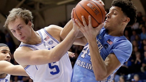 Duke's Luke Kennard (5) and North Carolina's Justin Jackson struggle for possession of the ball during the second half of an NCAA college basketball game in Durham, N.C., Thursday, Feb. 9, 2017. Duke won 86-78. (AP Photo/Gerry Broome)