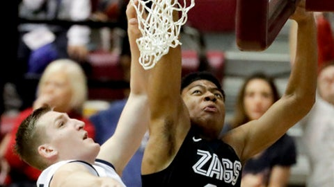 Gonzaga forward Rui Hachimura, right, shoots around Loyola Marymount center Mattias Markusson during the second half of an NCAA college basketball game in Los Angeles, Thursday, Feb. 9, 2017. Gonzaga won 90-60. (AP Photo/Chris Carlson)