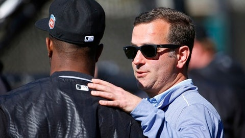 FILE - In this Feb. 22, 2016 file photo, Chicago White Sox general manager Rick Hahn talks to a player during a spring training baseball workout, in Glendale, Ariz. The White Sox made their intentions clear with two huge moves at the winter meetings, and they come to spring training stocked with new young players and a huge task still in front of them. (AP Photo/Ross D. Franklin, File)