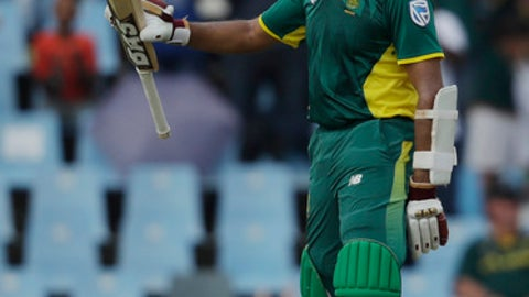 South Africa's batsman Hashim Amla raises his bat after reaching his century during the final One Day International cricket match between South Africa and Sri Lanka, at Centurion Park in Pretoria, South Africa, Friday, Feb. 10, 2017. (AP Photo/Themba Hadebe)
