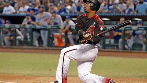 FILE - In this Sept. 17, 2016, file photo, Arizona Diamondbacks' Jean Segura watches the flight of his home run against the Los Angeles Dodgers during the first inning of a baseball game in Phoenix. Seattle's biggest offseason splash was acquiring Segura from Arizona, hoping he can replicate last season when he led the National League with 203 hits, and successfully make the move back to shortstop after spending most of last season at second base. (AP Photo/Ross D. Franklin, File)